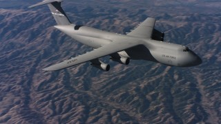 WAAF01_C015_0117VN - 4K stock footage aerial video of flying by the front end of a Lockheed C-5 flying over hills, Northern California