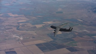 WAAF01_C017_011717 - 4K stock footage aerial video of tracking a Lockheed C-5 jet flying over farmland in Northern California