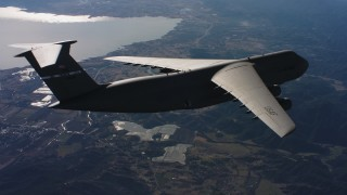 WAAF01_C033_0117BC - 4K stock footage aerial video of a Lockheed C-5 in flight near a lake in Northern California