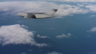 WAAF01_C045_0117KS - 4K stock footage aerial video of a Lockheed C-5 firing flares over the ocean in Northern California