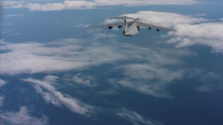 WAAF01_C049_01170M - 4K stock footage aerial video of a Lockheed C-5 dropping flares over the ocean in Northern California