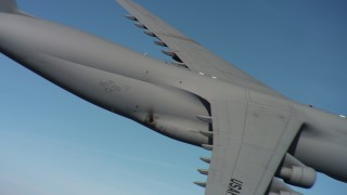 WAAF01_C062_0117SG - 4K stock footage aerial video of panning across the body of a Lockheed C-5 in flight over Northern California