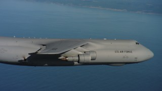 WAAF01_C063_0117RC_S000 - 4K stock footage aerial video track and pan across the body of a Lockheed C-5 over the ocean in Northern California