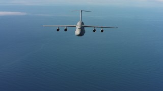 WAAF01_C066_01178K - 4K stock footage aerial video of a reverse view of a Lockheed C-5 flying over the ocean in Northern California