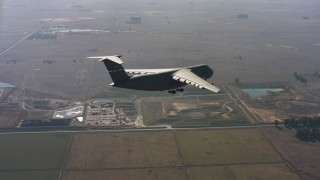 WAAF01_C084_0117LC - 4K stock footage aerial video of a Lockheed C-5 approaching Travis Air Force Base in Northern California