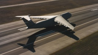 WAAF01_C085_01177E - 4K stock footage aerial video of a Lockheed C-5 landing at Travis Air Force Base, Northern California