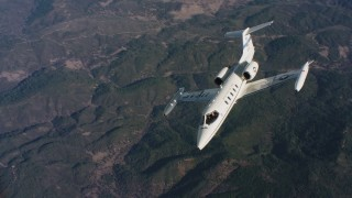 WAAF02_C019_0117JN_S002 - 4K stock footage aerial video of a Learjet C-21 flying from side to side over mountains in Northern California