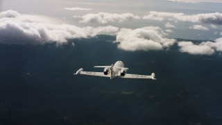 WAAF02_C029_0117CV_S001 - 4K stock footage aerial video of following a Learjet C-21 toward the ocean in Northern California