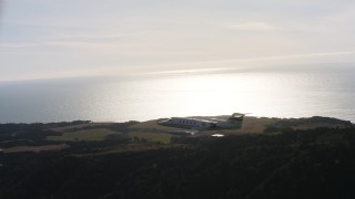 WAAF02_C048_0117VK - 4K aerial stock footage video of a Learjet C-21 flying over hills on the coast in Northern California