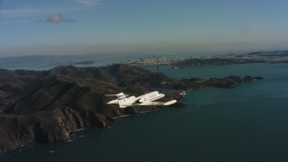 WAAF02_C051_01170K - 4K stock footage aerial video of a Learjet C-21 flying by Marin Hills and reveal San Francisco, California