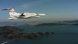 WAAF02_C051_01170K_S000 - 4K stock footage aerial video of a Learjet C-21 near Marin Hills, Golden Gate Bridge and San Francisco, California