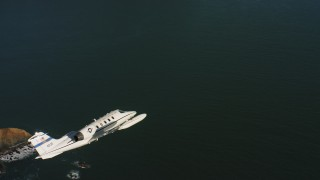WAAF02_C052_0117KW - 4K stock footage aerial video of a Learjet C-21 over the Pacific Ocean in Northern California