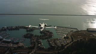 WAAF02_C054_0117PF_S000 - 4K stock footage aerial video of a reverse view of a Learjet C-21 flying over the bay in Northern California