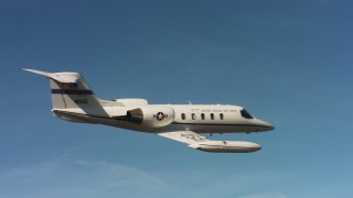 WAAF02_C061_01177W - 4K stock footage aerial video of a Learjet C-21 and blue skies in Northern California