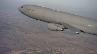 WAAF03_C007_01183X - 4K stock footage aerial video of a McDonnell Douglas KC-10 flying over hills in Northern California