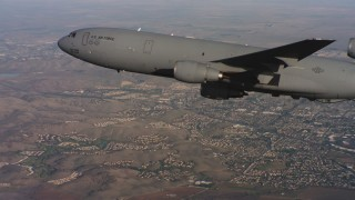 WAAF03_C008_01188V - 4K stock footage aerial video of a McDonnell Douglas KC-10 over neighborhoods in Northern California