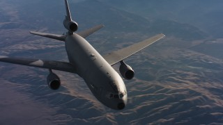 WAAF03_C014_01184M - 4K stock footage aerial video of flying by a McDonnell Douglas KC-10 in flight over hills and farms in Northern California