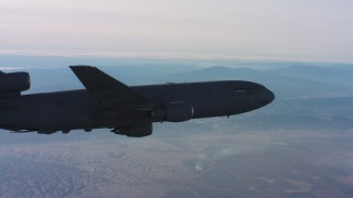 WAAF03_C016_0118KH - 4K stock footage aerial video of a McDonnell Douglas KC-10 flying away in Northern California