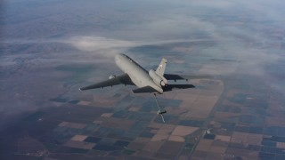 WAAF03_C018_011858 - 4K stock footage aerial video of flying around a McDonnell Douglas KC-10 lowering the refueling boom, Northern California