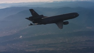 WAAF03_C022_0118MW - 4K stock footage aerial video of a McDonnell Douglas KC-10 with lowered refueling boom in Northern California