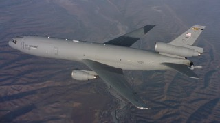 WAAF03_C023_0118T3_S000 - 4K stock footage aerial video of a McDonnell Douglas KC-10 raising the refueling boom in Northern California