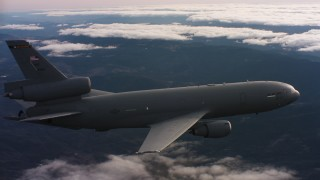 WAAF03_C032_01180B - 4K stock footage aerial video of a McDonnell Douglas KC-10 flying over mountains and clouds in Northern California