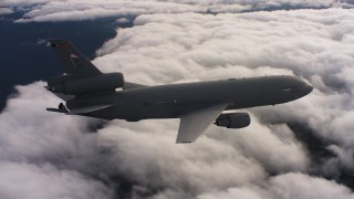 WAAF03_C033_011806 - 4K stock footage aerial video of a McDonnell Douglas KC-10 flying over clouds in Northern California