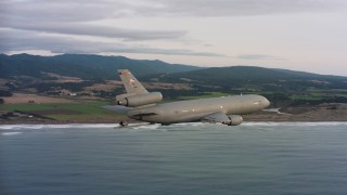 WAAF03_C042_011881_S000 - 4K stock footage aerial video of a McDonnell Douglas KC-10 in flight near the Northern California coast