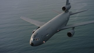 WAAF03_C044_01181Q - Aerial stock footage of 4K aerial ideo of flying around the nose of a McDonnell Douglas KC-10 over the ocean in Northern California