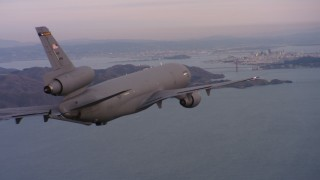 WAAF03_C058_0118S0 - 4K stock footage aerial video of a McDonnell Douglas KC-10 approaching San Francisco, California at sunset