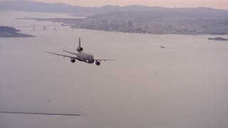 WAAF03_C061_011840 - 4K stock footage aerial video of a McDonnell Douglas KC-10 in flight near San Francisco, California at sunset