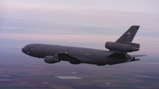 WAAF03_C069_01185P - 4K stock footage aerial video of a McDonnell Douglas KC-10 flying over farms at sunset in Northern California