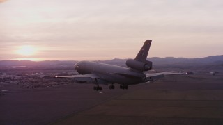 WAAF03_C074_0118AU - 4K stock footage aerial video of a McDonnell Douglas KC-10 approaching Travis Air Force Base at sunset, California