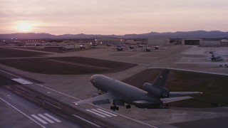 WAAF03_C074_0118AU_S000 - 4K stock footage aerial video of a McDonnell Douglas KC-10 landing at Travis Air Force Base at sunset, California