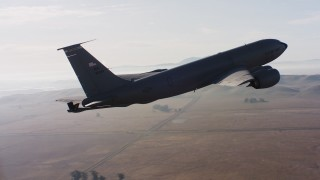 WAAF04_C007_01187P_S000 - 4K stock footage aerial video of a Boeing KC-135 in flight near Travis Air Force Base, California