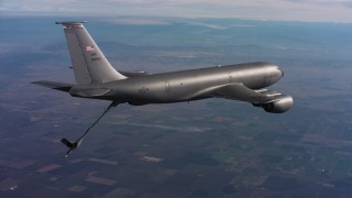 WAAF04_C011_0118FR - 4K stock footage aerial video of a Boeing KC-135 flying with lowered refueling boom in Northern California