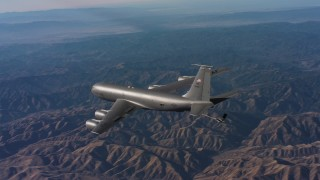WAAF04_C019_0118SM - 4K stock footage aerial video of revealing a Boeing KC-135 flying over mountains in Northern California