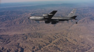 WAAF04_C027_0118PJ - 4K stock footage aerial video of a Boeing KC-135 flying over mountains in Northern California