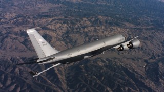 WAAF04_C038_01186H - 4K stock footage aerial video of a Boeing KC-135 lowering refueling boom above Northern California
