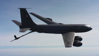 WAAF04_C039_0118J9_S001 - 4K stock footage aerial video of a Boeing KC-135 raising fuel boom in flight over Northern California