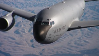 WAAF04_C043_0118NU - 4K stock footage aerial video of the nose and cockpit of a Boeing KC-135 in flight over Northern California