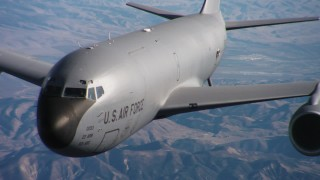 WAAF04_C045_01185M - 4K stock footage aerial video of panning across a Boeing KC-135 from engines to cockpit in Northern California