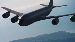 WAAF04_C050_011898 - 4K stock footage aerial video of a Boeing KC-135 flying near the coast of Northern California