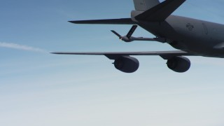 WAAF04_C059_0118N3 - 4K stock footage aerial video of the refueling boom on a Boeing KC-135 over Northern California