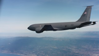 WAAF04_C062_0118SH - 4K stock footage aerial video of a Boeing KC-135 flying near the coast in Northern California