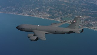 WAAF04_C063_0118FX - 4K stock footage aerial video of a Boeing KC-135 over the ocean by the coast in Northern California