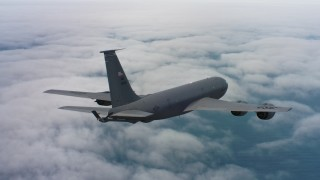 WAAF04_C070_0118HE - 4K stock footage aerial video of a Boeing KC-135 above clouds over the Pacific Ocean in Northern California