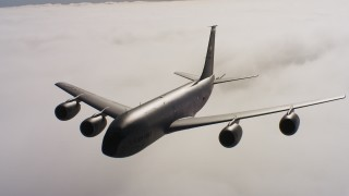 WAAF04_C074_0118RV - 4K stock footage aerial video of a Boeing KC-135 in flight over low clouds in Northern California