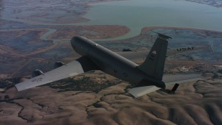 WAAF04_C085_0118RQ - 4K stock footage aerial video of flying around the tail of a Boeing KC-135 over Northern California