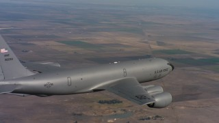 WAAF04_C090_0118SM - 4K stock footage aerial video of flying around a Boeing KC-135 over farms in Northern California